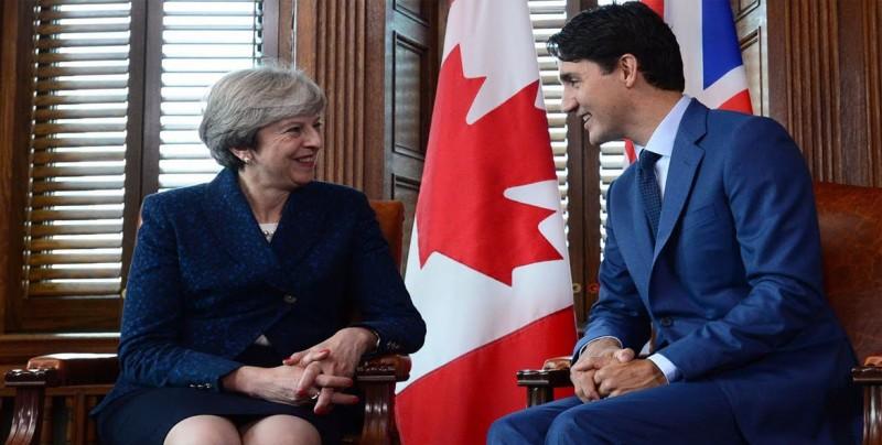 Theresa May y Justin Trudeau se reúnen antes del inicio de la Cumbre del G7