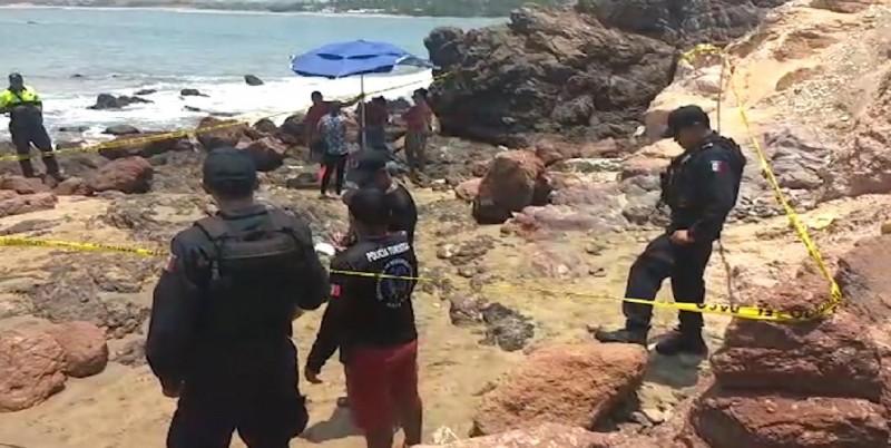 Muere ahogado mientras rescataba a su nieto del mar