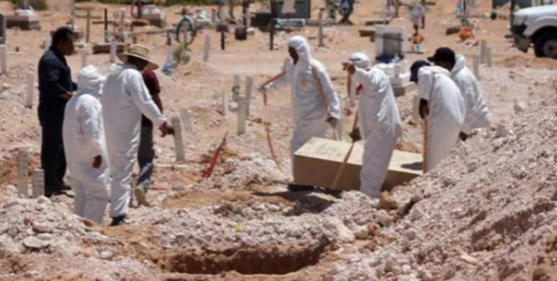 Hallan 19 cuerpos en fosa clandestina en Jalisco
