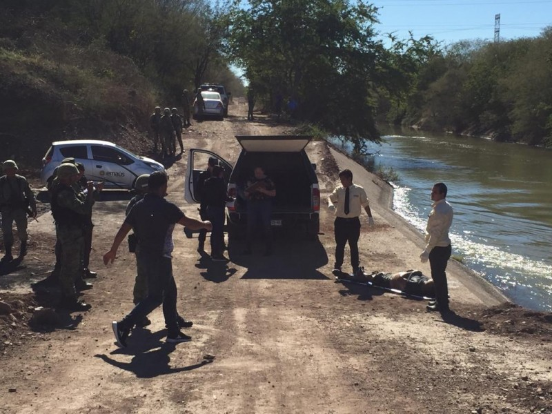 Encuentran muerto  en el  canal  San Lorenzo a Policía Militar