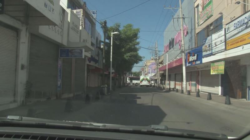 Desolado y con comercios cerrados lució el centro de Culiacán este viernes