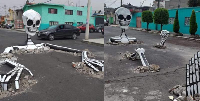 Como México no hay dos: Vecinos aprovechan baches y colocan calaveras gigantes