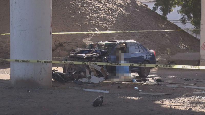 Asesinan a balazos a hombre y cae del puente desnivel en el Palmito