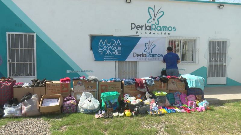 Dona fundación Perla Ramos ropa y alimentos a municipio de Morelos, Chihuahua
