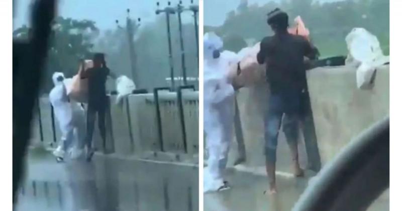 Graban a dos hombres arrojando al río un cadáver de fallecido por Covid-19 (video)