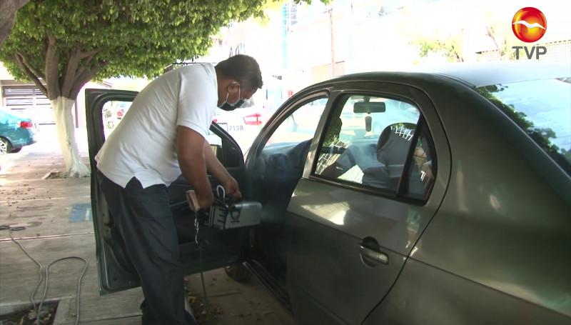 Sindicato de Ecotaxis Verdes sanitiza tu vehículo sin costo